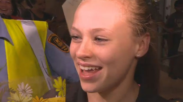 Gymnast Ellie Black was overcome with emotion as she arrived to hugs, cheers and tears.