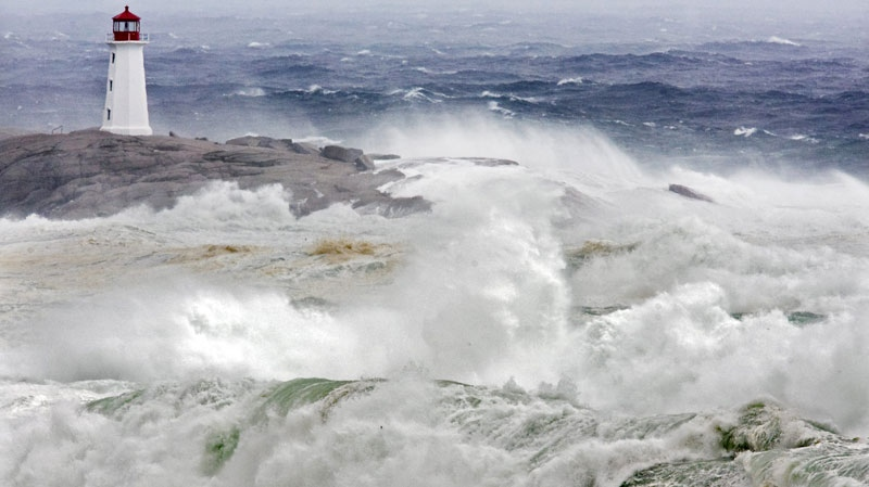Waves from Hurricane Earl pound the coast at Peggys Cove, N.S. on Saturday, Sept. 4, 2010. (Andrew Vaughan / THE CANADIAN PRESS).