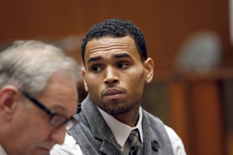Chris Brown appears in a Los Angeles courtroom with his attorney Mark Geragos Monday, Sept. 24, 2012. (AP/David McNew, Pool)