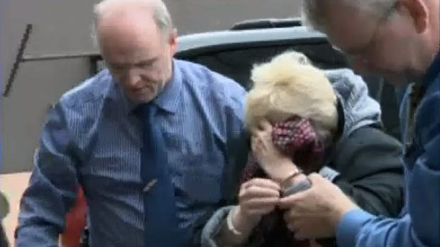Melissa Weeks is escorted into Cape Breton Regional Police headquarters in Sydney for questioning on Oct. 1, 2012.
